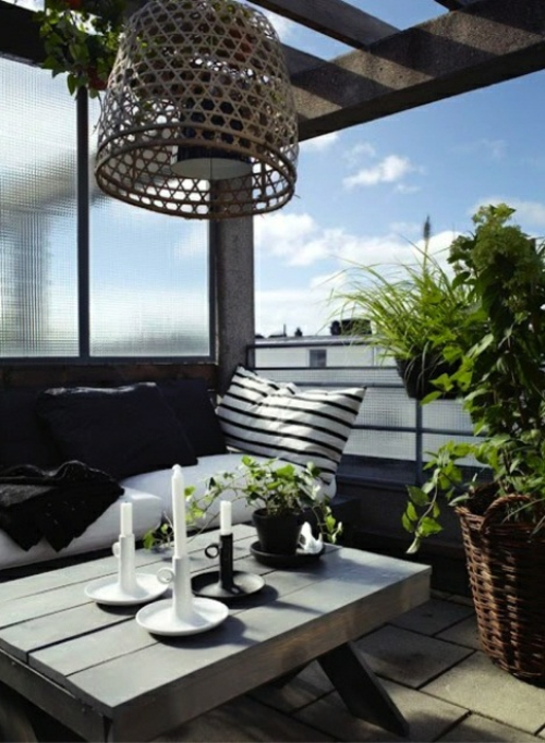 Roof terrace furnishing cool view candles wooden table