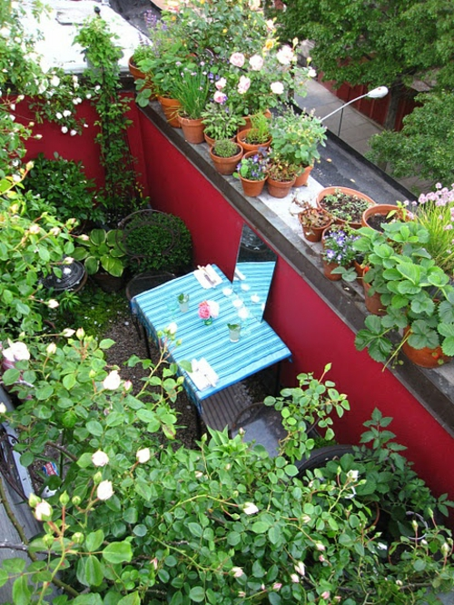 designer roof terrace furnishing cool table chairs red accent